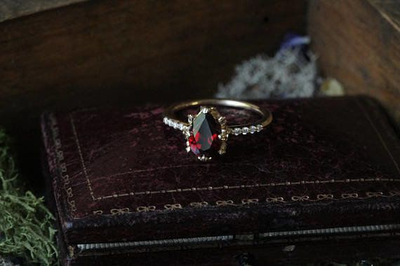 "<i>Buy it from <a href=""https://www.etsy.com/listing/491794784/garnet-engagement-ring-pear-engagement?ref=shop_home_active_20"