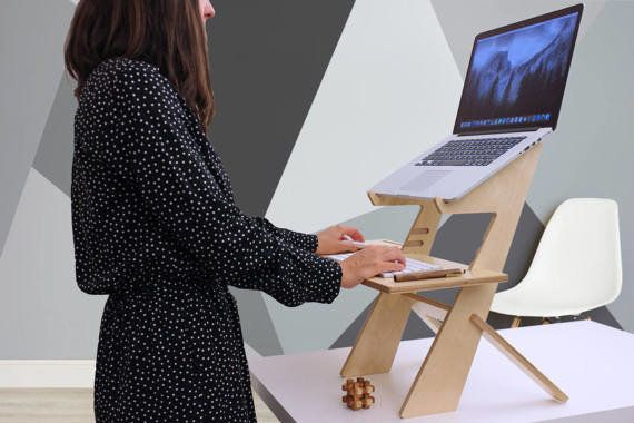 This handmade desk is made to order and customized to your height. The sleek design of this tabletop standing desk ensures it