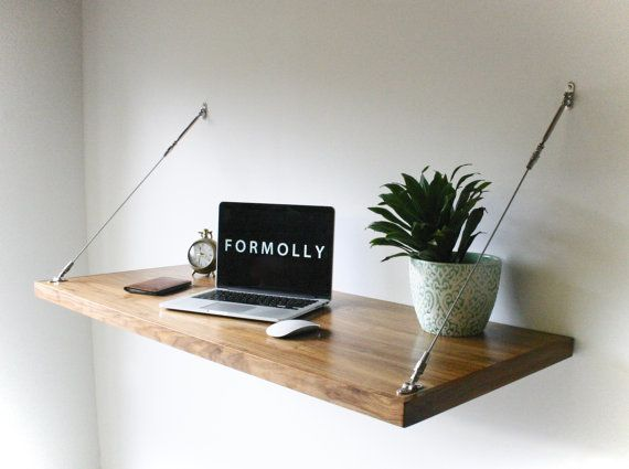Customize your own workspace with this wall mount desk, which you can hang at any height without taking up any floor space.&n