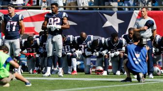 Sep 24, 2017; Foxborough, MA, USA; Members of the New England Patriots take a knee during the national anthem before a game against the Houston Texans at Gillette Stadium. Mandatory Credit: Greg M. Cooper-USA TODAY Sports