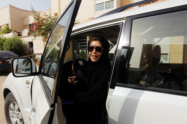 Female driver Azza Al Shmasani alights from her car after driving in defiance of the ban in Riyadh in