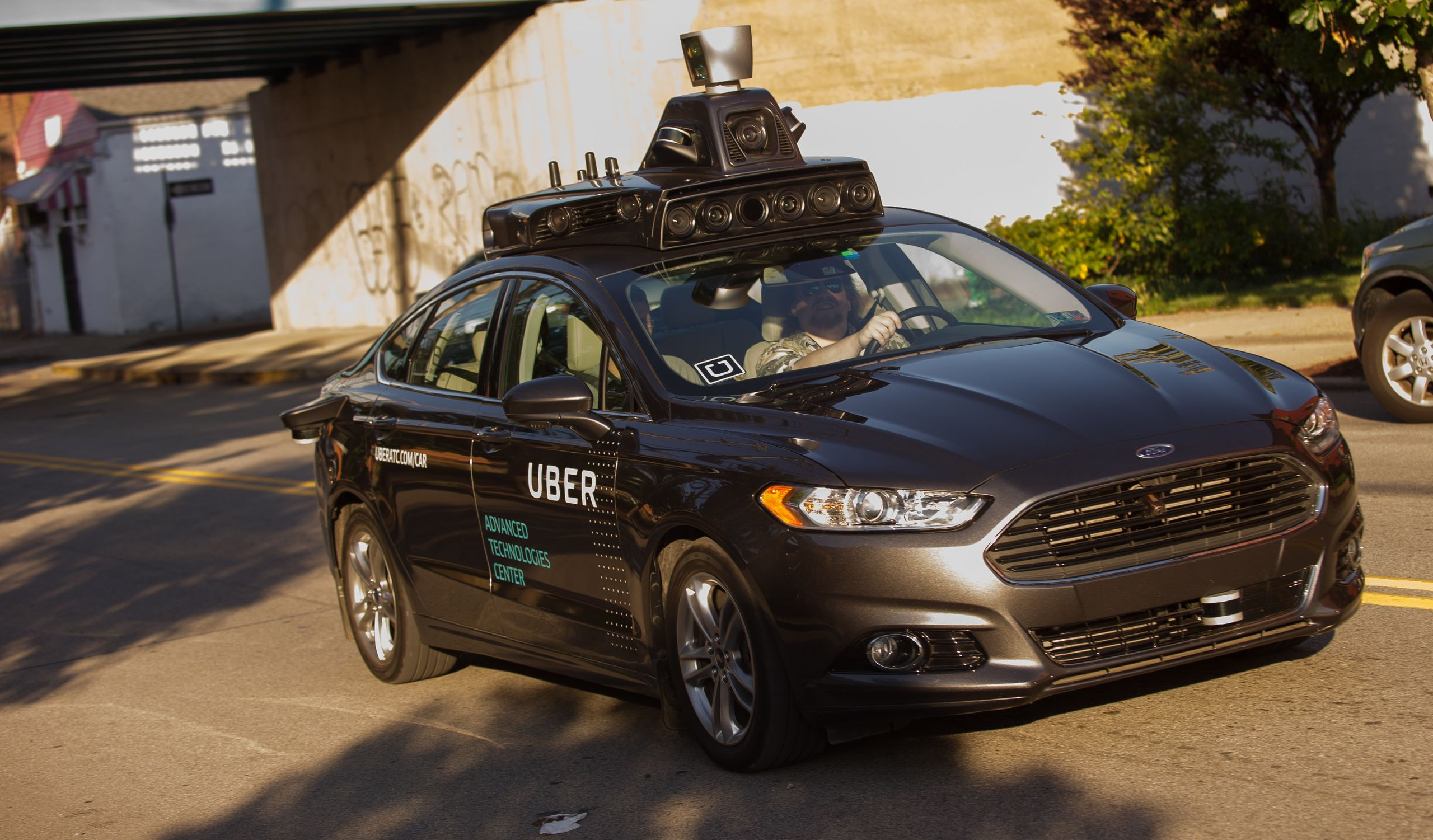 An Uber autonomous Ford Fusion drives through Pittsburgh in September 2016. The company, which now partners with Volvo, curre