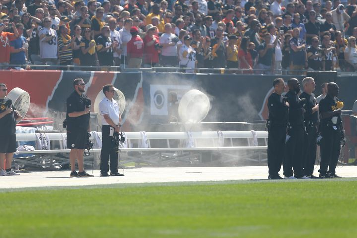 The Pittsburgh Steelers' bench was empty during the national anthem at Chicago's Soldier Field on Sunday.