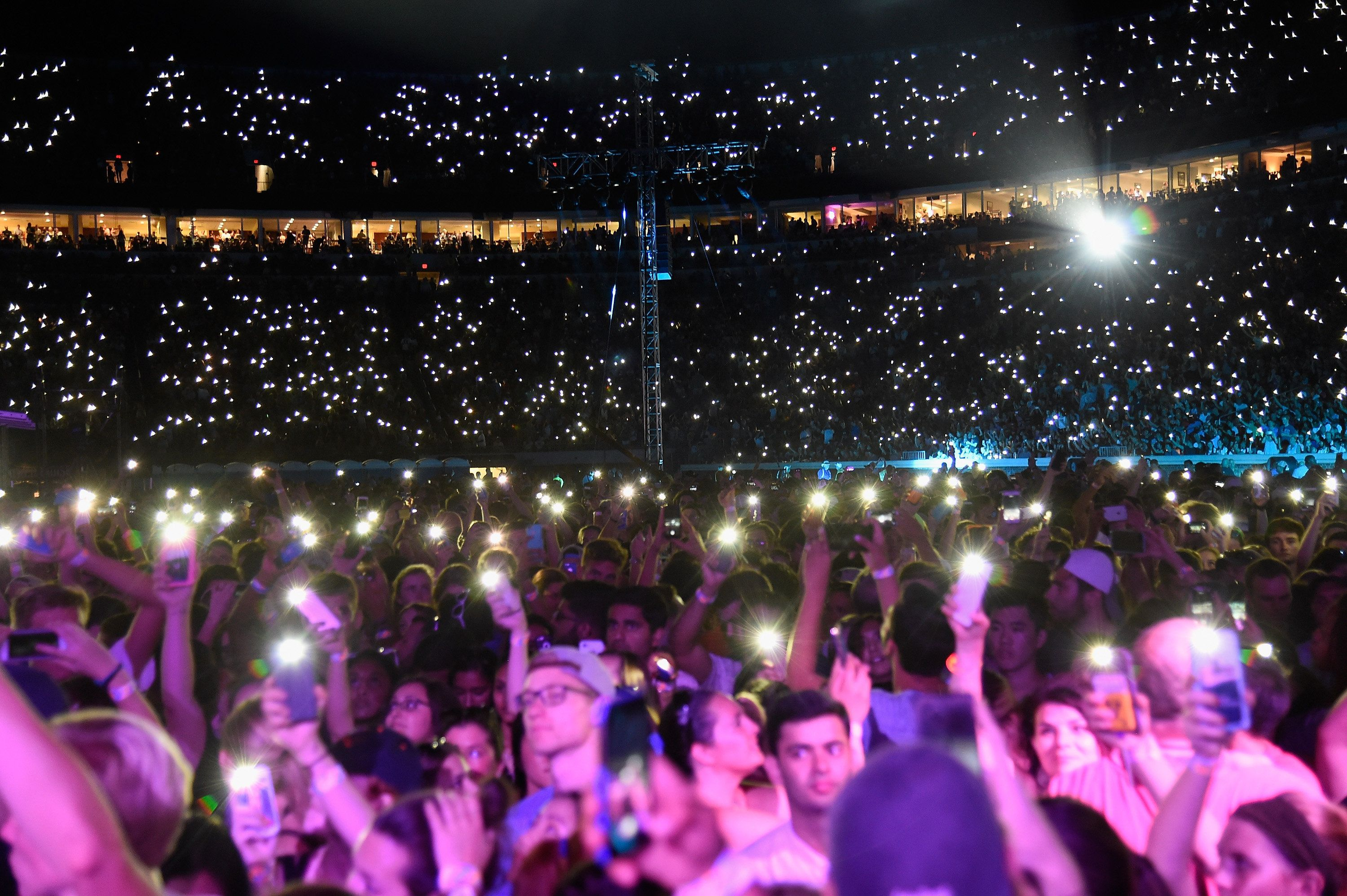 CHARLOTTESVILLE, VA - SEPTEMBER 24:  Fans hold up their cell phones with the lights on at 'A Concert for Charlottesville,'  at University of Virginia's Scott Stadium on September 24, 2017 in Charlottesville, Virginia. Concert live-stream presented in partnership with Oath.  (Photo by Kevin Mazur/Getty Images)