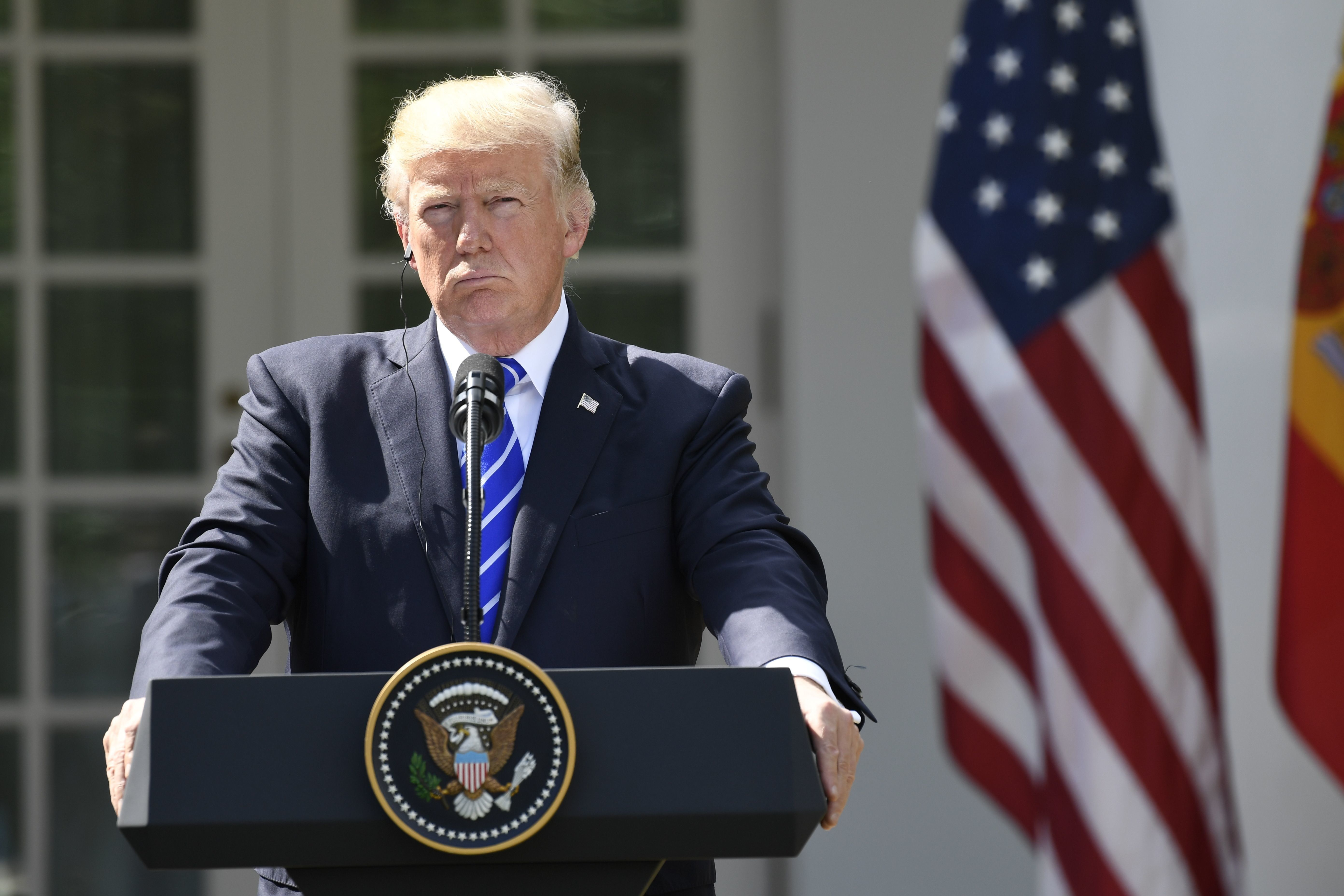 US President Donald Trump holds a joint press conference with Spanish Prime Minister Mariano Rajoy in the Rose Garden of the White House in Washington, DC, September 26, 2017. / AFP PHOTO / SAUL LOEB        (Photo credit should read SAUL LOEB/AFP/Getty Images)