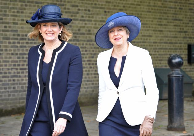 Prime Minister Theresa May and Home Secretary Amber Rudd (left)arrive ahead of a ceremonial welcome for...