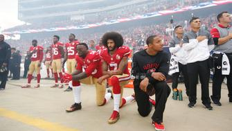 SANTA CLARA, CA - DECEMBER 11: Eli Harold #58, Colin Kaepernick #7 and Eric Reid #35 of the San Francisco 49ers kneel on the sideline, during the anthem, prior to the game against the New York Jets at Levi Stadium on December 11, 2016 in Santa Clara, California. The Jets defeated the 49ers 23-17. (Photo by Michael Zagaris/San Francisco 49ers/Getty Images)