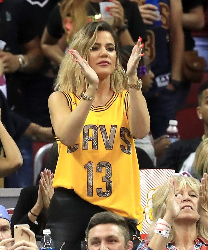 Khloe Kardashian cheers at a Cleveland Cavaliers game.