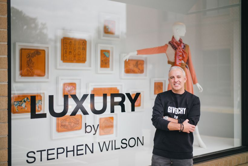 <em>Stephen Wilson in front of his pop-up show at Capitol in Charlotte, NC.</em>