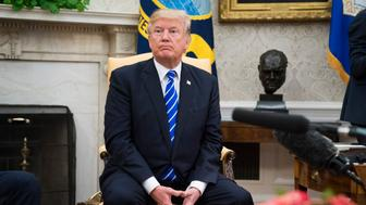 WASHINGTON, DC - SEPTEMBER 26: President Donald Trump listens during a meeting with Spanish Prime Minister Mariano Rajoy in the Oval Office at the White House in Washington, DC on Tuesday, Sept 26, 2017. (Photo by Jabin Botsford/The Washington Post via Getty Images)