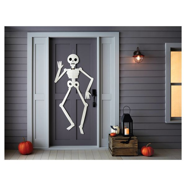 "Get it here from <a href=""https://www.target.com/p/halloween-large-paper-skeleton-wall-decor-hyde-and-eek-boutique-153/-/A-52"