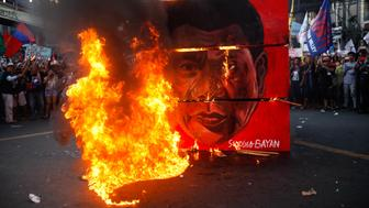 A cubic effigy painted with the face of President Rodrigo Duterte is set on fire by activists during a rally commemorating the 45th anniversary of the declaration of Martial Law in Manila, Philippines, 21 September 2017. Cause-oriented groups held demonstrations in different parts of the Philippines on the 45th anniversary of the declaration of Martial Law in the country to protest Philippine President Rodrigo Duterte's authoritarian tendencies, as well as the extrajudicial killings brought by his administration's so-called 'War on Drugs.' (Photo by Richard James Mendoza/NurPhoto via Getty Images)