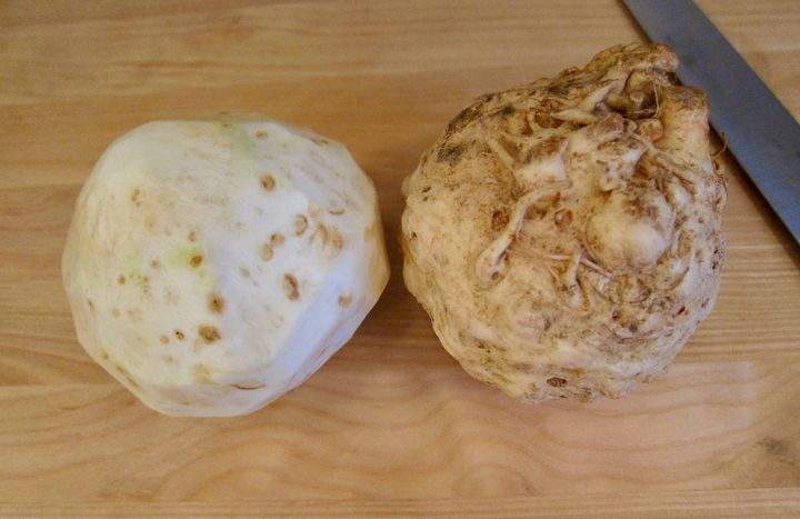 <p>Two celery roots, one peeled</p>