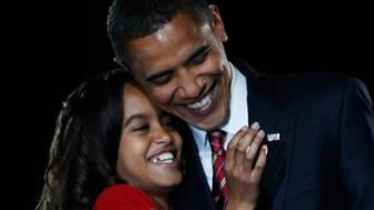 CHICAGO - NOVEMBER 04:  U.S. President elect Barack Obama embraces his daughter Malia after Obama gave his victory speech during an election night gathering in Grant Park on November 4, 2008 in Chicago, Illinois. Obama defeated Republican nominee Sen. John McCain (R-AZ) by a wide margin in the election to become the first African-American U.S. President elect.  (Photo by Joe Raedle/Getty Images)