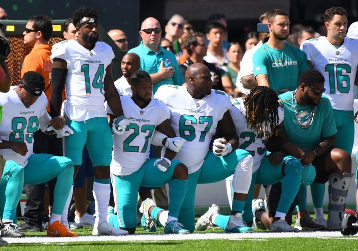 Some of the Miami Dolphins take a knee during the anthem prior to the game against the New York Jets at MetLife Stadium.&nbsp