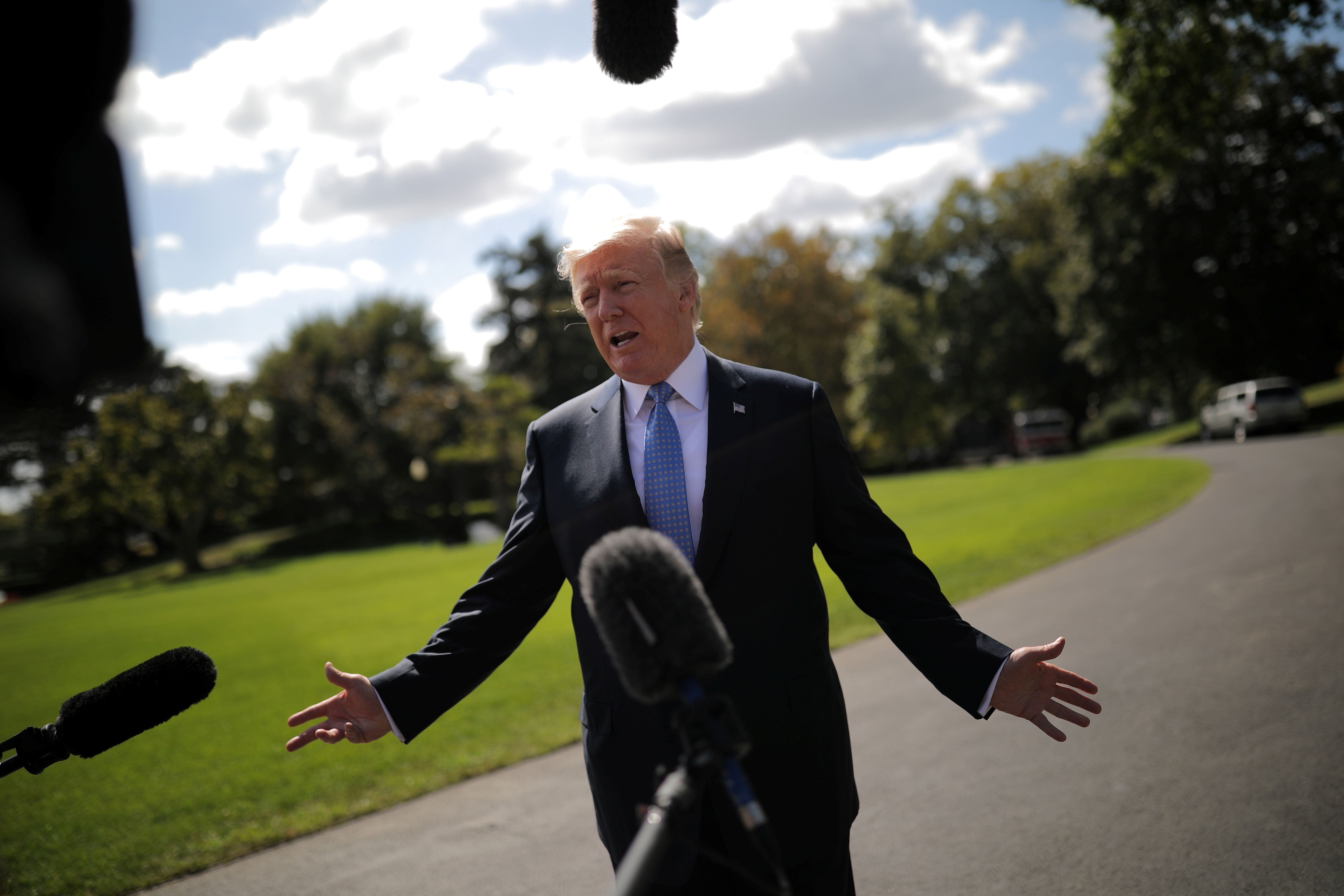 U.S. President Donald Trump talks with reporters as he departs the White House for Indianapolis, in Washington, U.S., September 27, 2017. REUTERS/Carlos Barria