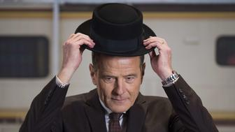 US actor Bryan Cranston tries on a prop hat for his Walter White/Heisenberg character from the AMC television series 'Breaking Bad' at the National Museum of American History in Washington, DC, November 10, 2015, during a memorabilia donation ceremony.      AFP PHOTO / JIM WATSON        (Photo credit should read JIM WATSON/AFP/Getty Images)