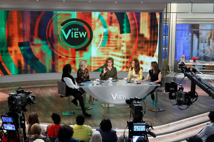 "Bila sits across the table from longtime ""View"" co-host Whoopi Goldberg."