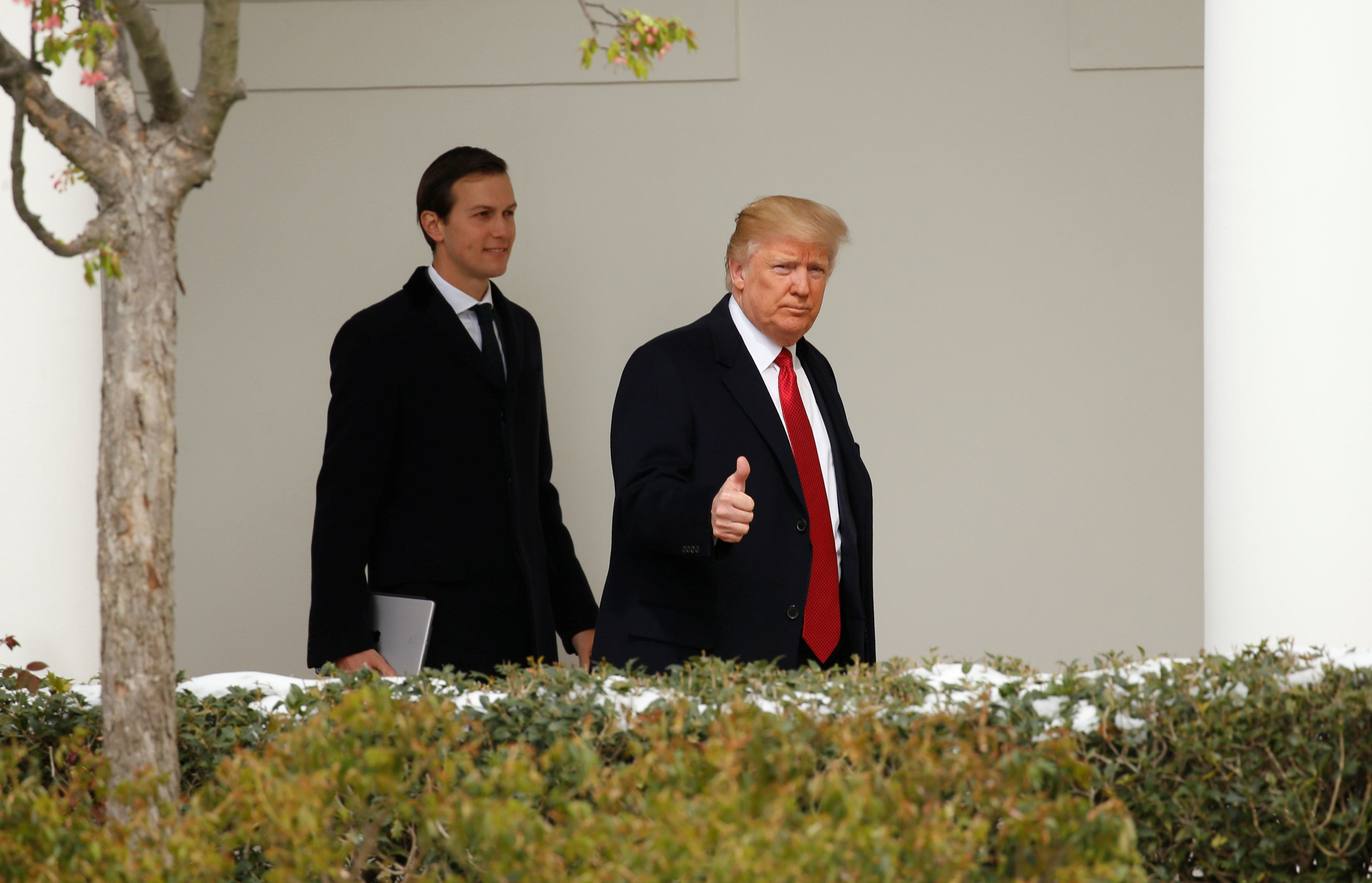 U.S. President Donald Trump gives a thumbs-up as he and White House Senior Advisor Jared Kushner depart the White House in Washington, U.S., March 15, 2017. REUTERS/Kevin Lamarque