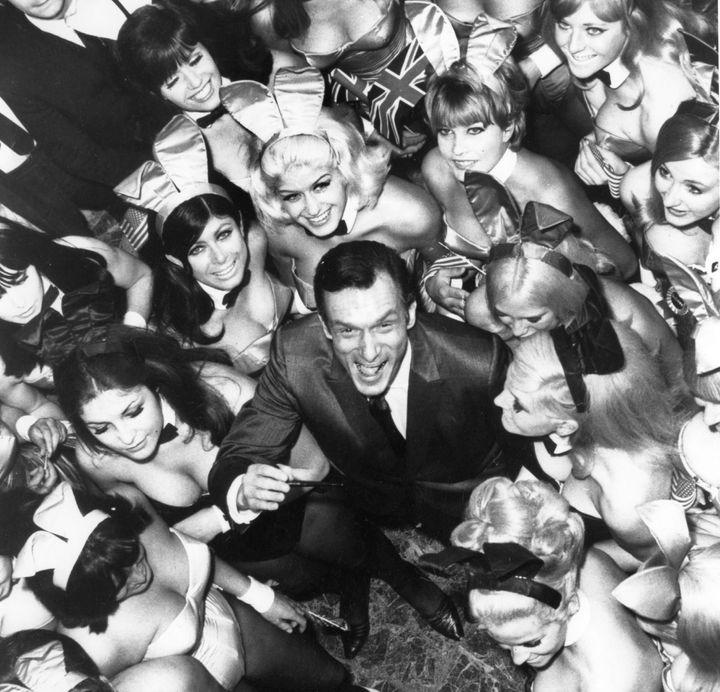 Hugh Hefner surrounded by 50 of his Playboy Bunnies on June 27, 1966, in London.