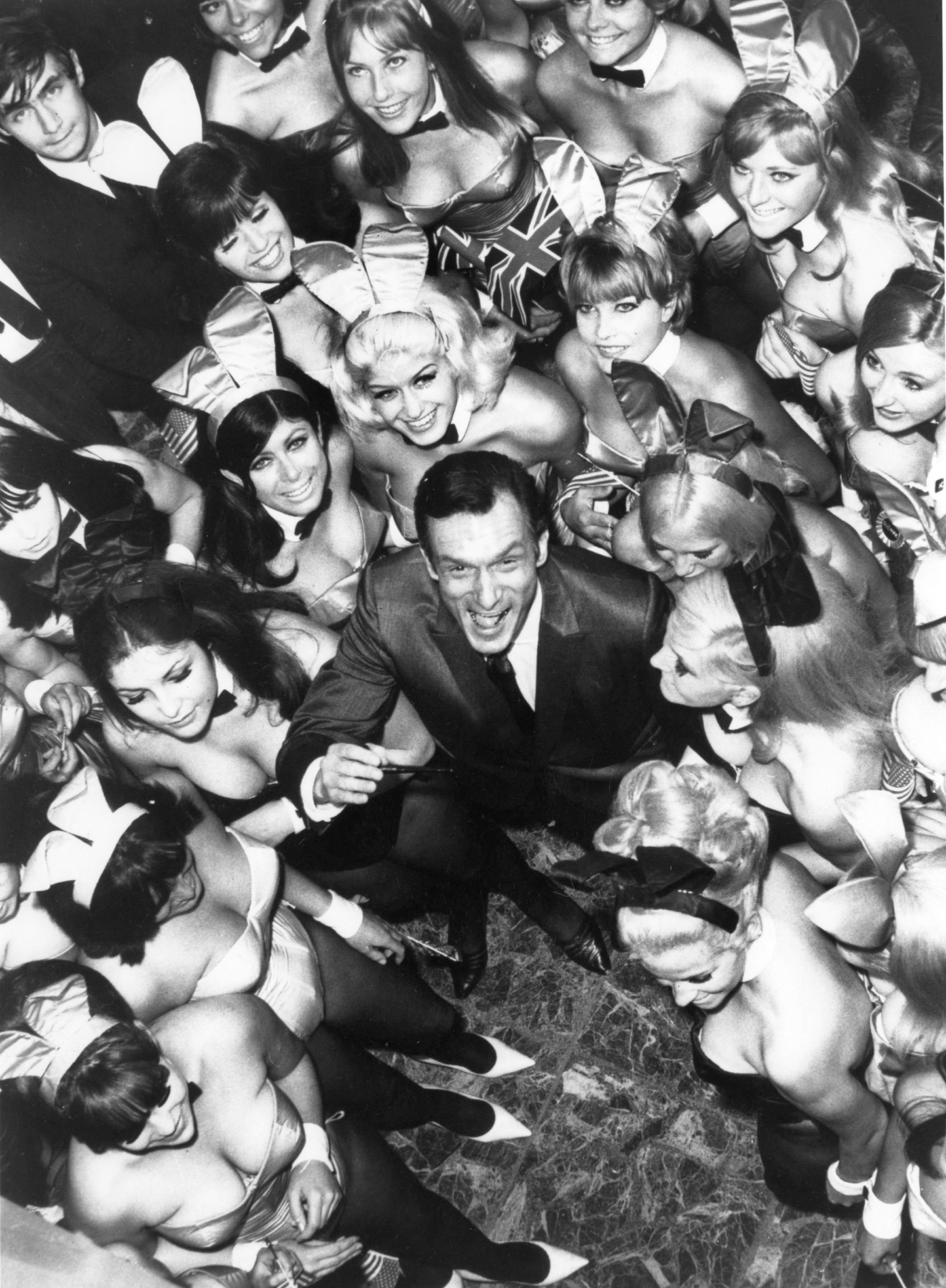 UNITED KINGDOM - AUGUST 26:  Hugh Hefner, The Director Of The Play-Boy Newspaper And Club, Pictured Surrounded By 50 Bunnies On June 27, 1966. They Were To Work At His New Club In London  (Photo by Keystone-France/Gamma-Keystone via Getty Images)