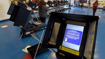 Voting machines are set up for people to cast their ballots during voting in the 2016 presidential election at Manuel J. Cortez Elementary School in Las Vegas, Nevada, U.S November 8, 2016.  REUTERS/David Becker