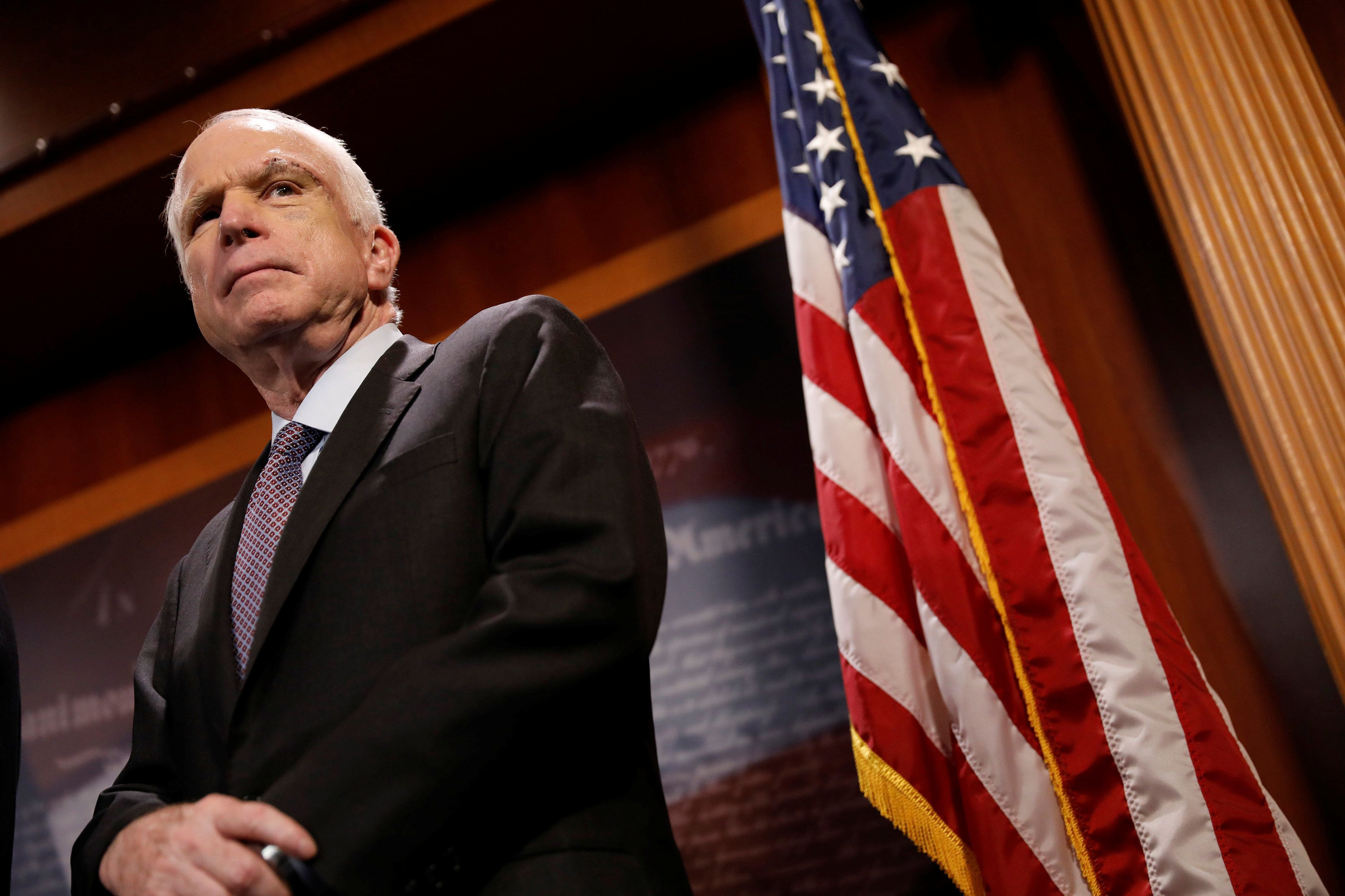 """Senator John McCain (R-AZ) looks on during a press conference about his resistance to the so-called """"Skinny Repeal"""" of the Affordable Care Act on Capitol Hill in Washington, U.S., July 27, 2017. REUTERS/Aaron P. Bernstein"""