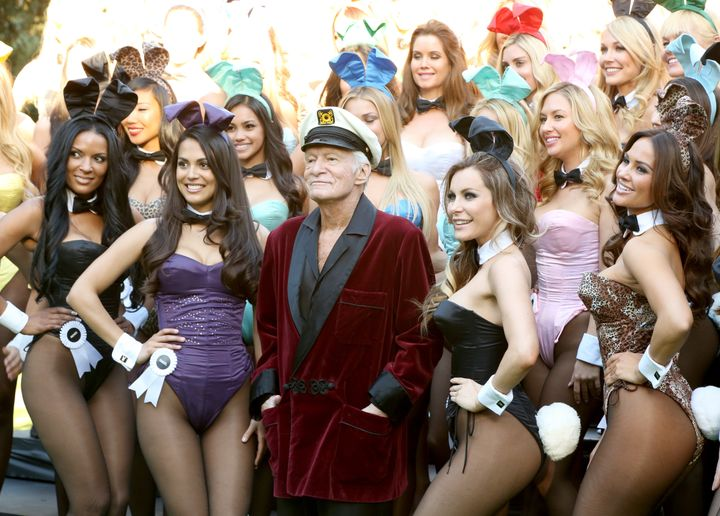 Hugh Hefner is surrounded by Playboy Bunnies and is flanked by Playmate of the Year 2013 Raquel Pomplun (left) and his wife,