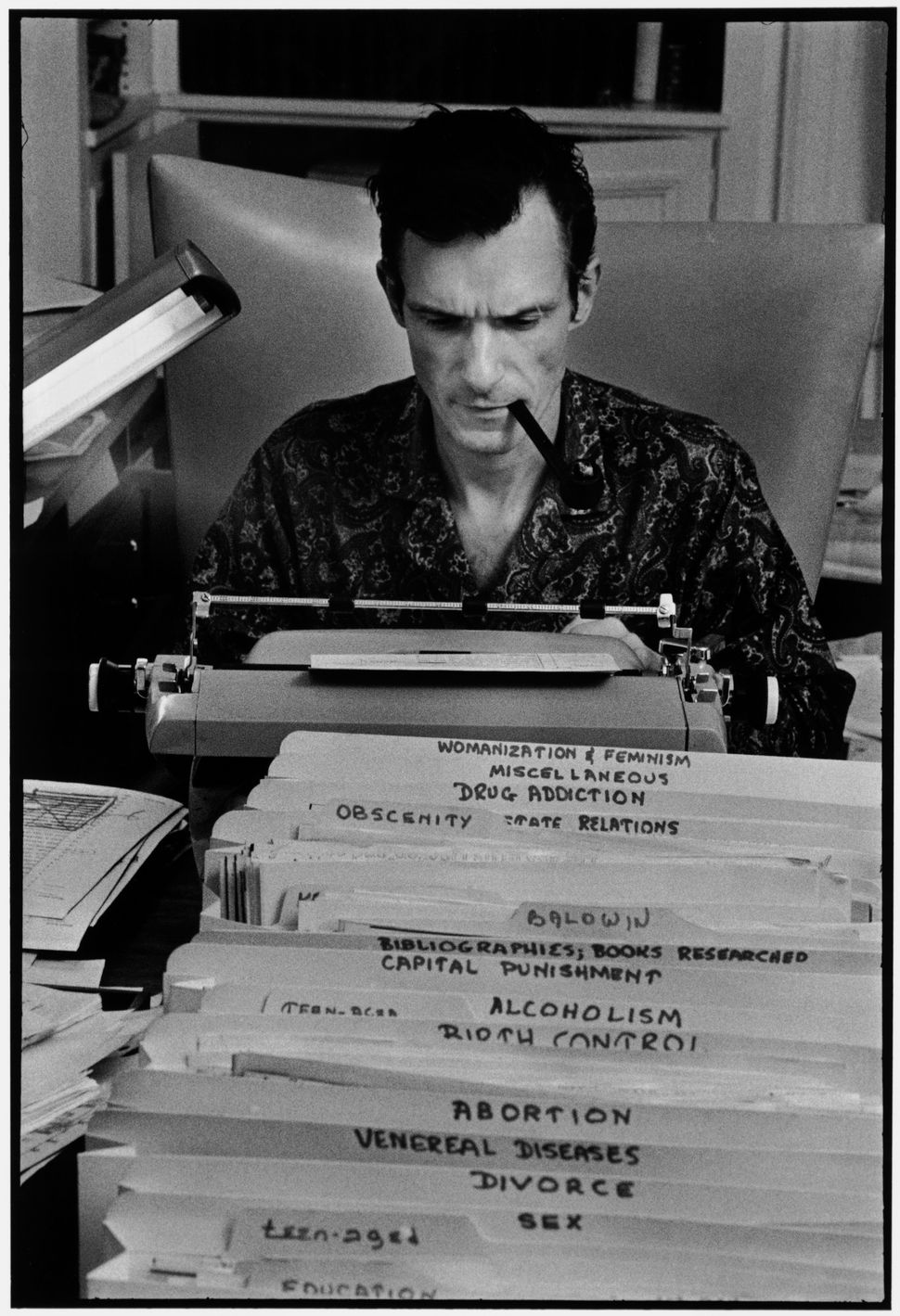"Burt Glinn, ""Playboy founder Hugh Hefner typing at his desk in his mansion,"" Chicago, IL, USA, 1966"