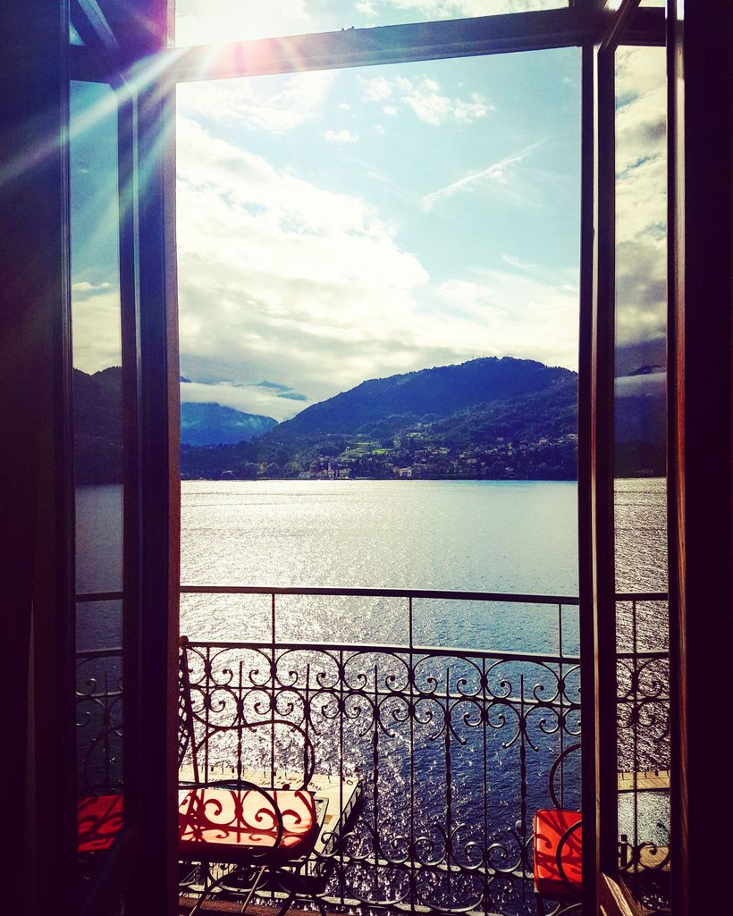Lake-view rooms have quaint terraces, outfitted for two in The Grand Hotel Tremezzo's trademark orange.