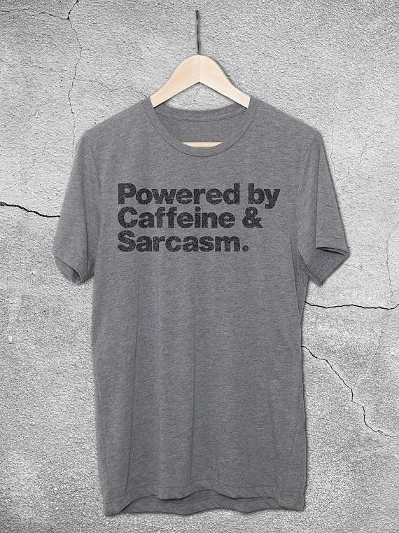 "<a href=""https://www.etsy.com/listing/537563861/powered-by-caffeine-sarcasm-t-shirt?ga_order=most_relevant&ga_search_type"