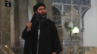 This July 5, 2014 photo shows an image grab taken from a propaganda video released by al-Furqan Media allegedly showing the leader of the Islamic State (IS) jihadist group, Abu Bakr al-Baghdadi, aka Caliph Ibrahim, adressing Muslim worshippers at a mosque in the militant-held northern Iraqi city of Mosul. Baghdadi, who on June 29 proclaimed a 'caliphate' straddling Syria and Iraq, purportedly ordered all Muslims to obey him in the video released on social media.   In early 2014 the self-styled Islamic State entered the northern Syrian city of Raqqa, declaring it their capital and beginning a reign of terror marked by grisly public executions. Armed sharia police patrolled the streets as 'enemies' of the regime were crucified or decapitated, their severed heads impaled on spikes in the city square. / AFP PHOTO / -        (Photo credit should read -/AFP/Getty Images)