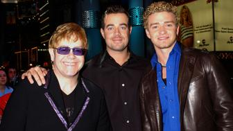 Elton John, Carson Daly and Justin Timberlake during Elton John and Justin Timberlake Visit MTV's 'TRL' - January 11, 2002 at MTV's Time Square Studios in New York City, New York, United States. (Photo by KMazur/WireImage)