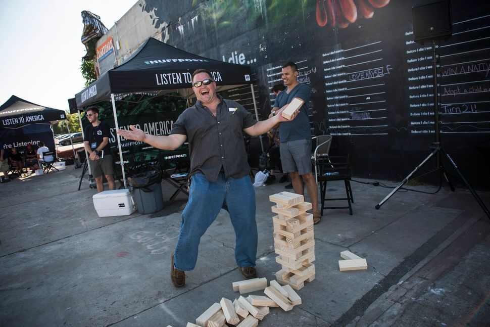 Raymond Goffin gestures after he loses a game of Jumbo Jenga.