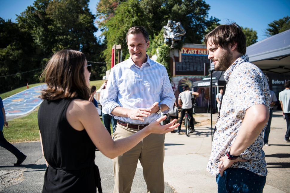 Robyn Malcolm and Marc Janks speak to Charlottesville Mayor Michael Signer.