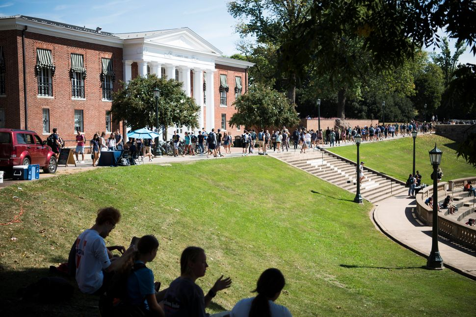 Studentswalk to class at the University of Virginia.