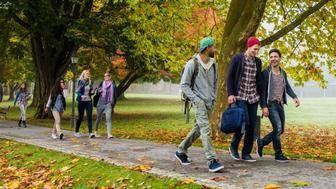 University students having fun while walking in campus.