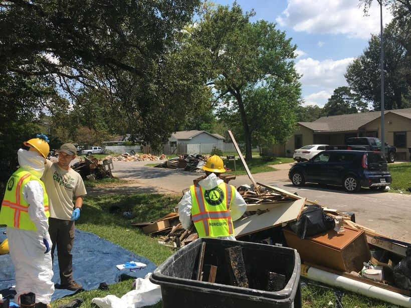 AmeriCorps members with Conservation Corps Minnesota Iowa helping gut Houston homes damaged by Hurricane Harvey.