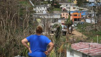 COROZAL, PUERTO RICO - SEPTEMBER 27:  Irma Santiago surveys her neighborhood as people deal with the aftermath of Hurricane Maria on September 27, 2017 in Corozal, Puerto Rico.  Puerto Rico experienced widespread, severe damage including most of the electrical, gas and water grids as well as agricultural destruction after Hurricane Maria, a category 4 hurricane, passed through.  (Photo by Joe Raedle/Getty Images)