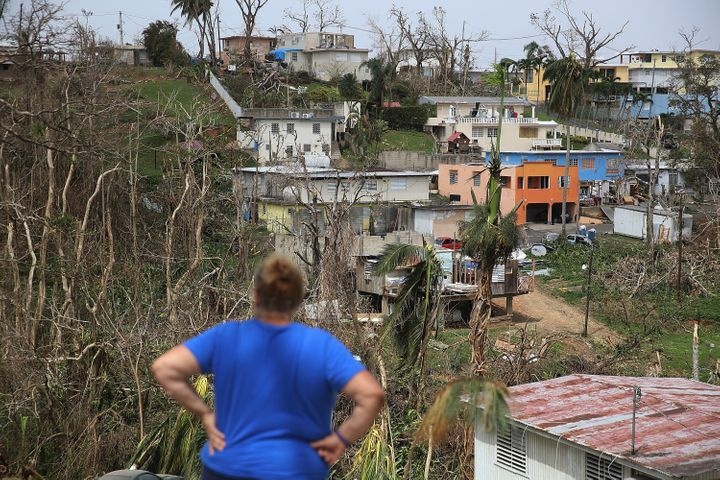 Irma Santiago surveys her in Corozal neighborhood as Puerto Ricans deal with the aftermath of Hurricane Maria on Wednesday.