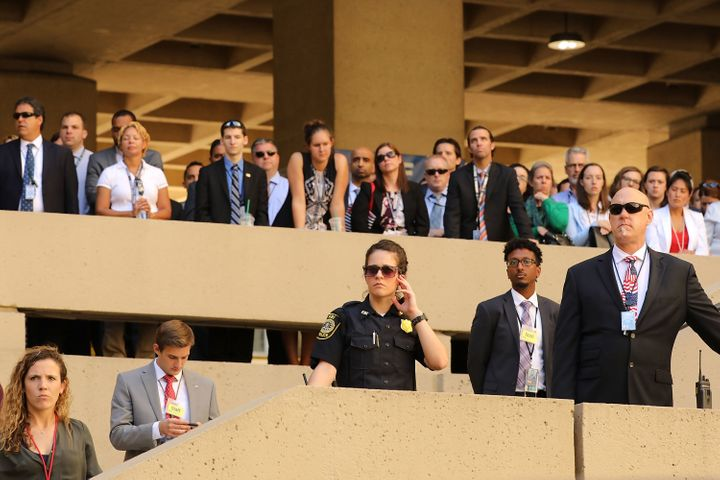 FBI employees and guests look on during the ceremony.