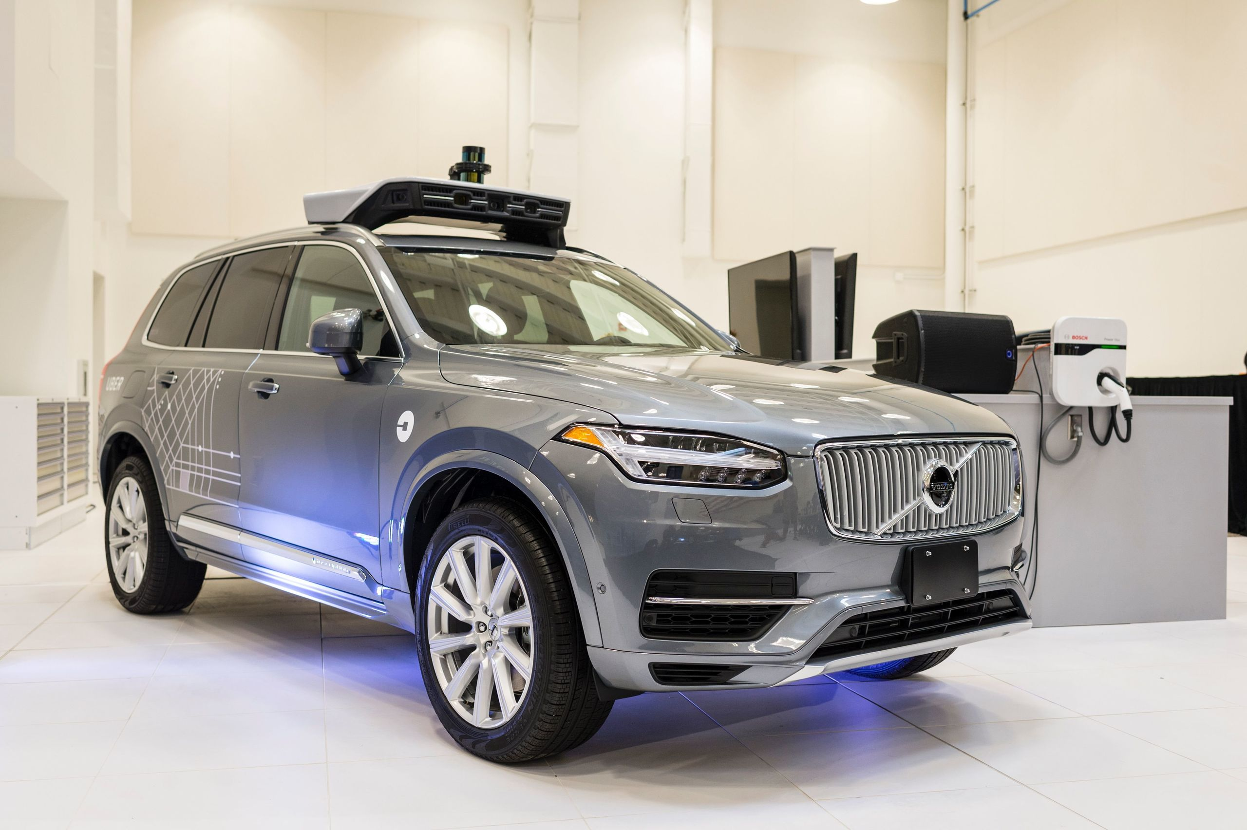 Uber's self-driving vehicles are topped with rotating sensors. This pilot model is displayed at the Uber Advanced Technologie