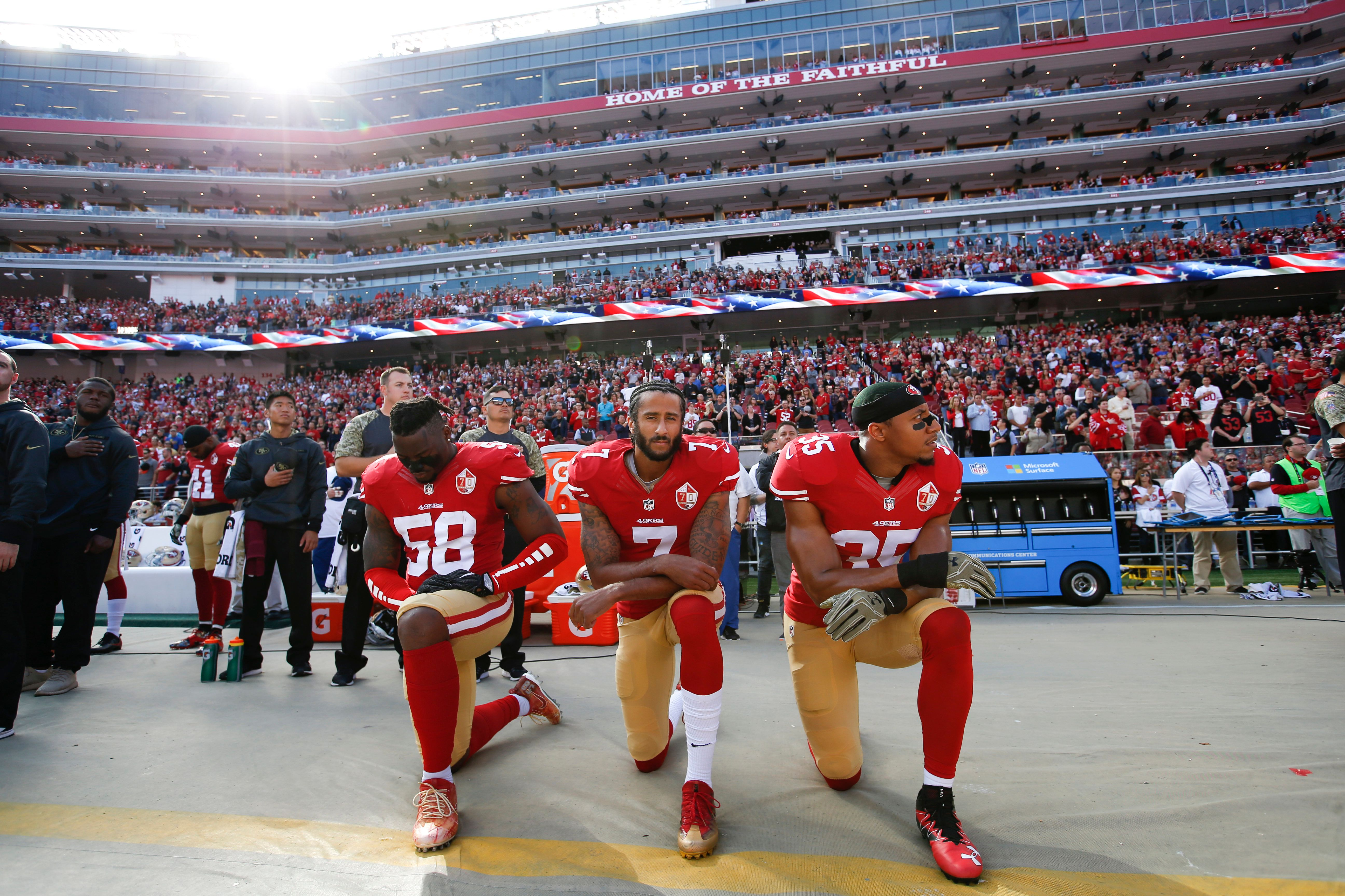 SANTA CLARA, CA - NOVEMBER 6: Eli Harold #58, Colin Kaepernick #7 and Eric Reid #35  of the San Francisco 49ers kneel on the sideline during the anthem prior to the game against the New Orleans Saints at Levi Stadium on November 6, 2016 in Santa Clara, California. The Saints defeated the 49ers 41-23. (Photo by Michael Zagaris/San Francisco 49ers/Getty Images)