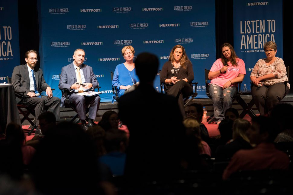An audience member asks host Rob Byers (far left) and panelists Mike Brumage, Andrea Darr, Amanda Dietz, Brandi Gunnoe and Lo