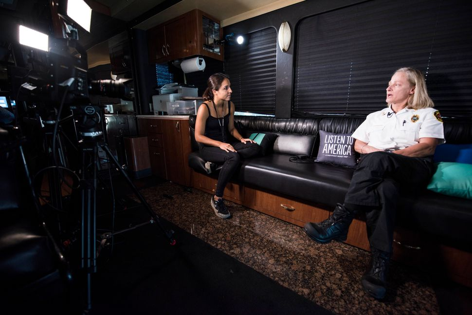 Fire Chief Jan Rader is interviewed by Sarah Grossman on the HuffPost bus.