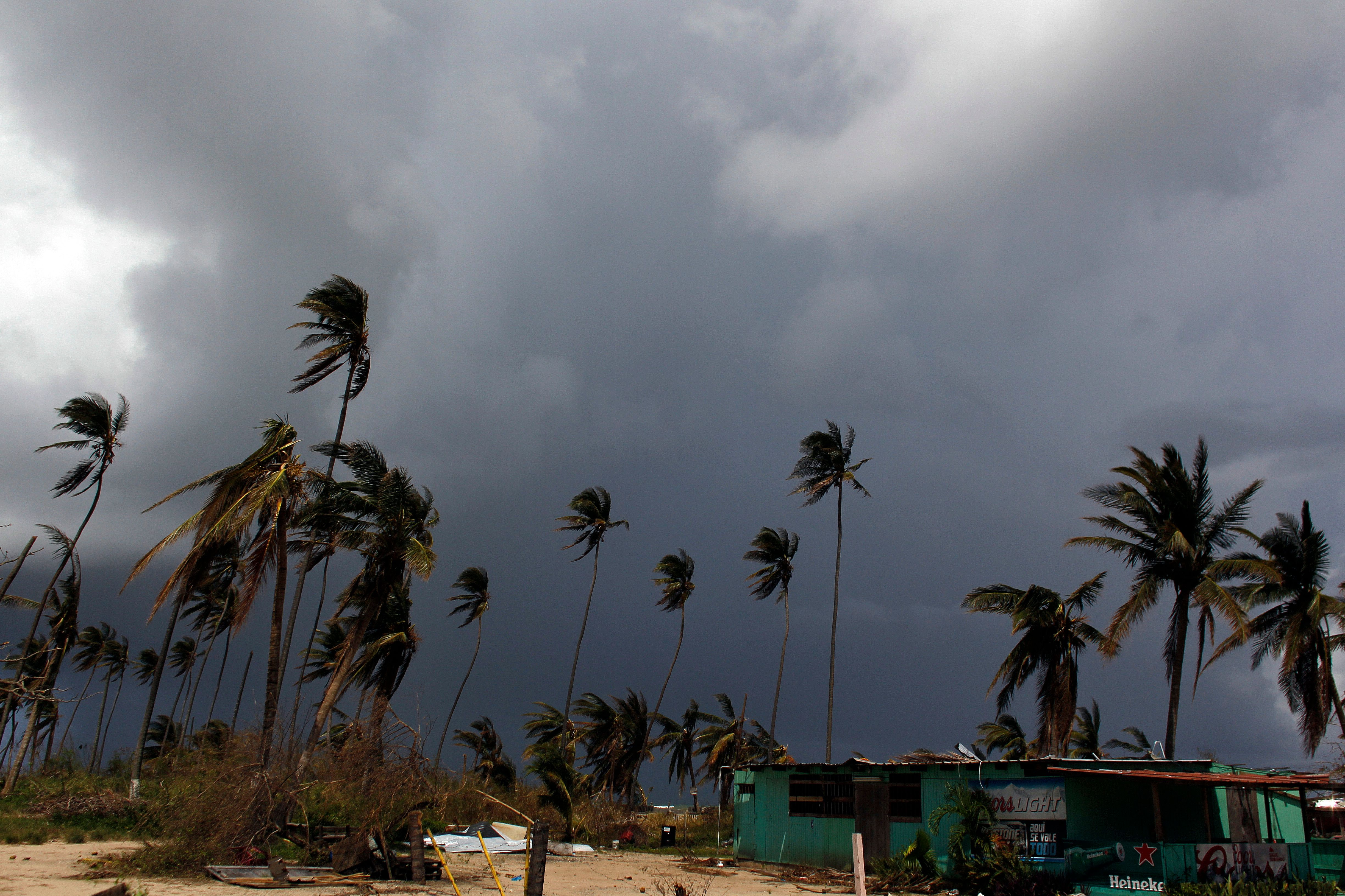 Heavy rain clouds are seen in the aftermath of Hurricane Maria, in Loiza, Puerto Rico, September 28, 2017. The US island territory, working without electricity, is struggling to dig out and clean up from its disastrous brush with the hurricane, blamed for at least 33 deaths across the Caribbean. / AFP PHOTO / Ricardo ARDUENGO / The erroneous mention[s] appearing in the metadata of this photo by Ricardo ARDUENGO has been modified in AFP systems in the following manner: [Dateline : LOIZA] instead of [YABUCOA]. Please immediately remove the erroneous mention[s] from all your online services and delete it (them) from your servers. If you have been authorized by AFP to distribute it (them) to third parties, please ensure that the same actions are carried out by them. Failure to promptly comply with these instructions will entail liability on your part for any continued or post notification usage. Therefore we thank you very much for all your attention and prompt action. We are sorry for the inconvenience this notification may cause and remain at your disposal for any further information you may require.        (Photo credit should read RICARDO ARDUENGO/AFP/Getty Images)