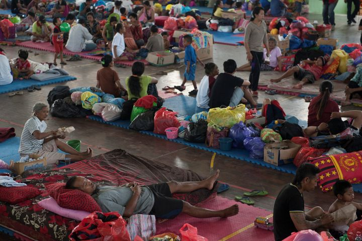 Evacuees are being housed in tents, school gyms, and government buildings in neighboring villages.
