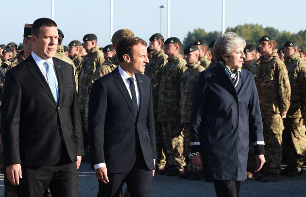 (L-R) Estonian Prime Minister Juri Ratas, French President Emmanuel Macron and British Prime Minister...