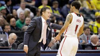 INDIANAPOLIS, IN - MARCH 17:  Head coach Rick Pitino of the Louisville Cardinals talks with Quentin Snider #4 of the Louisville Cardinals against the Jacksonville State Gamecocks during the first round of the 2017 NCAA Men's Basketball Tournament at Bankers Life Fieldhouse on March 17, 2017 in Indianapolis, Indiana.  (Photo by Andy Lyons/Getty Images)