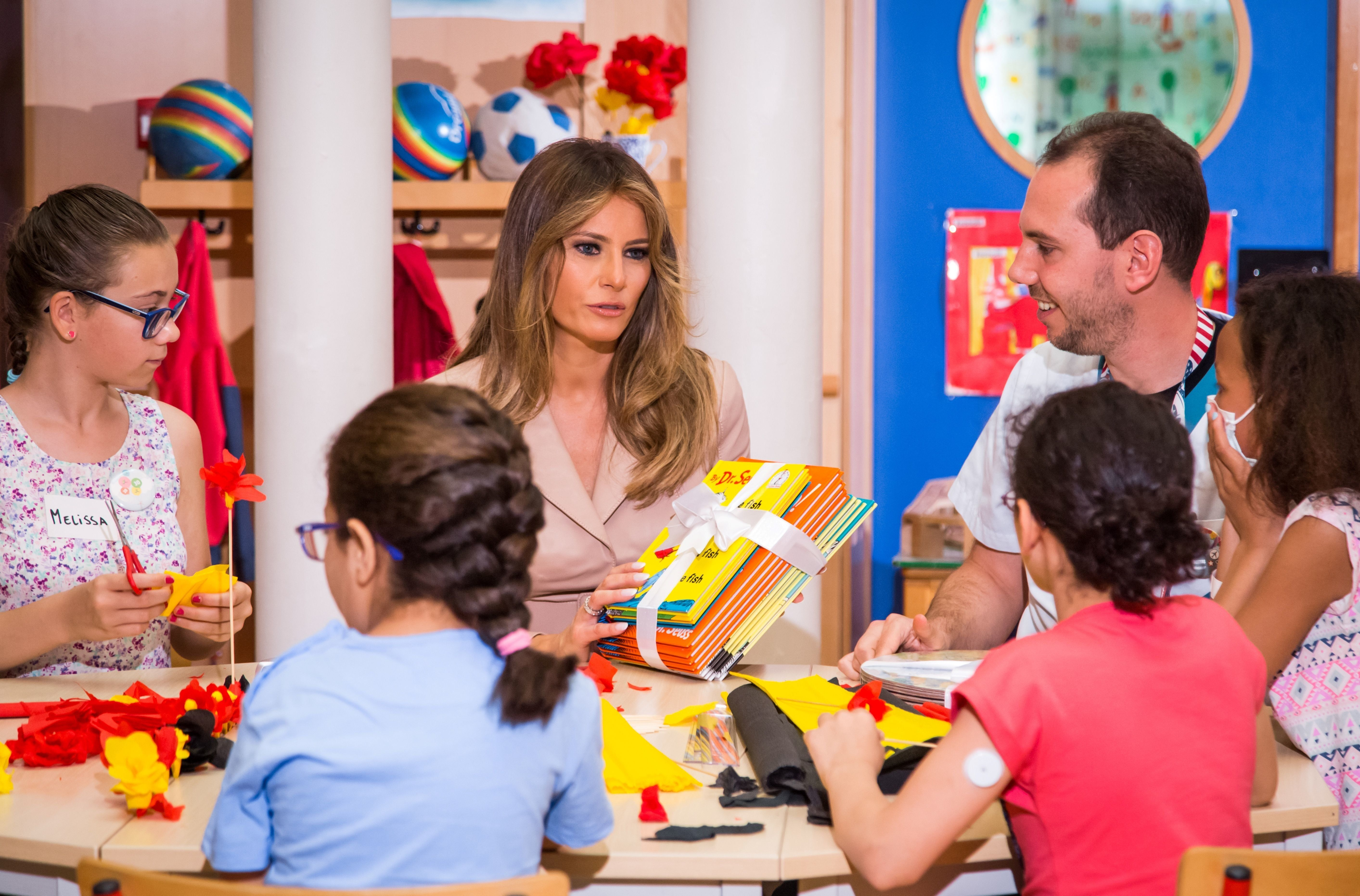 Melania Trump gives Dr. Seuss booksto patients as she visits the Queen Fabiola Children's Hospital in Brussels in May.